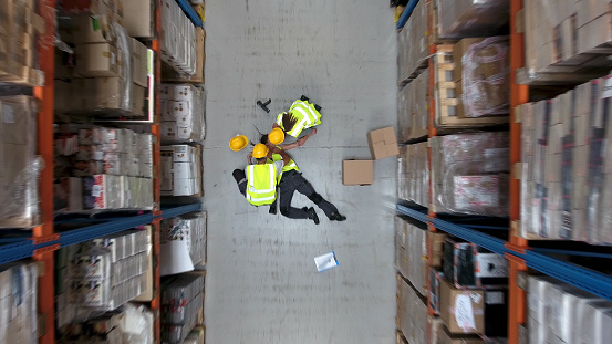 Worker lying on the floor after an accident